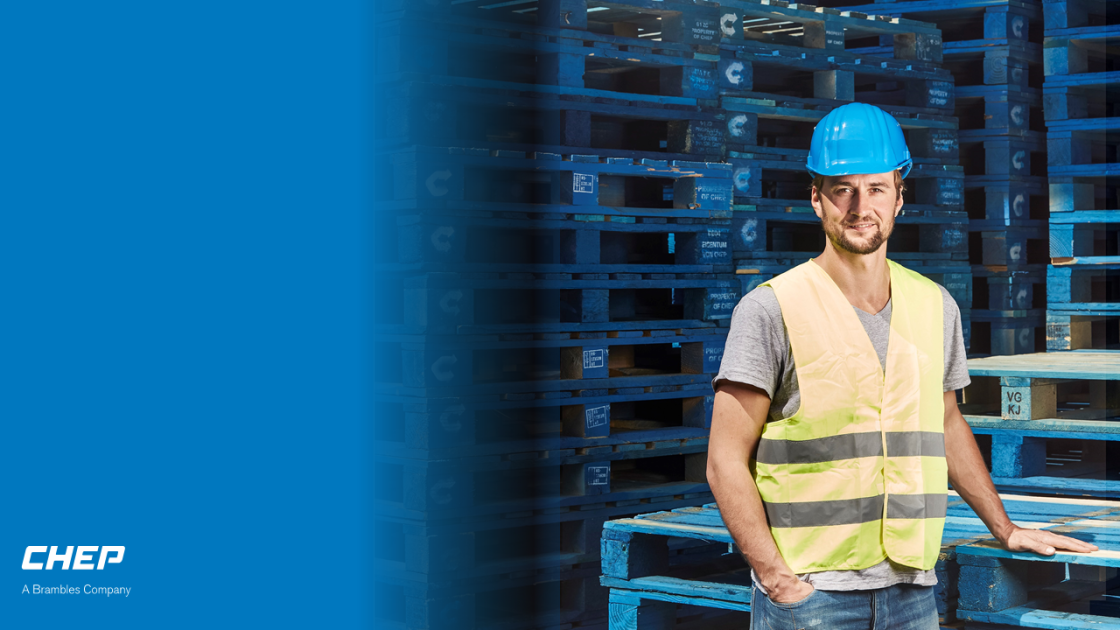 CHEP Employee in front of blue pallets in Service center