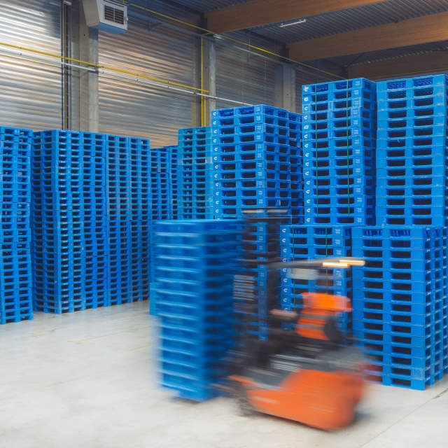 plastic pallets piled up in service center